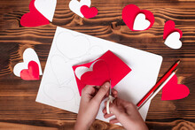 Valentines Diy. Step By Step Instructions For Handmade Valentine. Craft Gift, Flat Lay. Step 3. Cut Your Heart Out Of Red Paper, Along Lines.