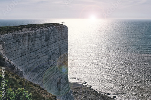 Obraz the crazy moves and courage of two crazy people on the rocks over the sea - fototapety do salonu