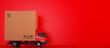 Leinwandbild Motiv Big cardboard box package on a red truck ready to be delivered