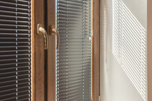 Brown Plastic Windows With Black Aluminum Blinds