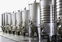 Modern Wine Factory With New Large Tanks For The Fermentation. Modern Wine Cellar With Stainless Steel Tanks.