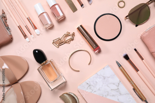 Obraz Cosmetic products and accessories on beige background, flat lay - fototapety do salonu