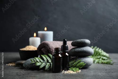 Spa composition with aroma oil on grey table