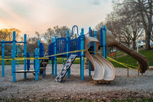 Park Playground Equipment Cordoned Off With Yellow Caution Tape
