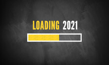 Text LOADING 2021 With A Loading Bar Indicator On A Blackboard