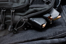 A Tactical Bag Full Of Loaded Magazines For A Hand Gun