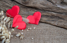 Red Hearts On Natural Wooden And Burlap Background. Valentines Day Greeting Card. Eco Friendly Concept.