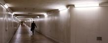 Silhouette Of Businessman Walking In Dark Underground Passage 暗い地下道を歩くビジネスマンのシルエット