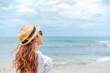 Leinwandbild Motiv smiling young woman in sun hat on beach. summer, holidays, vacation, travel concept