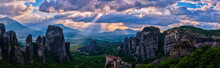Panorama Of Meteora, Greece, Valley And Mountains At Sunset. Sun Rays, Hills, Villages Of Kalampaka And Kastraki, Great Clouds. UNESCO World Heritage
