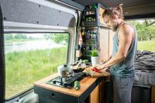 Young Man Living In A Camper Van