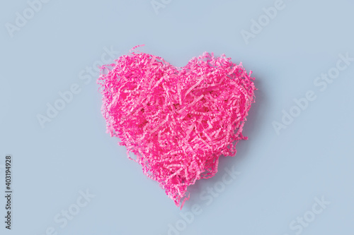 Shape of pink heart like tangle of packaging material, greeting card on blue bac Fotobehang