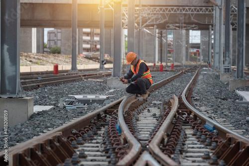 Obraz na płótnie engineer sitting on railway inspection