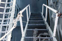 Top View Of Metal Staircase Steps On Ship Deck Of Battleship Or Navy Ship