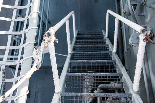Fotografiet Top view of metal staircase steps on ship deck of battleship or navy ship