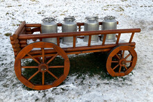Milk Cans On A Wooden Cart In Vintage Style On The Snow.