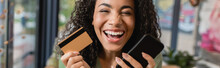 Cheerful African American Woman Laughing While Holding Smartphone And Credit Card, Banner