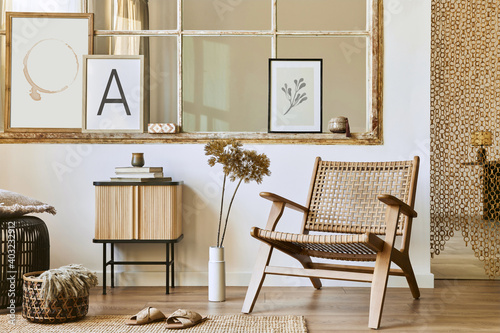 Fotomural Unique living room interior with stylish rattan armchair,  design furniture, dried flowers, mock up poster frames,  wooden floor, decoration and elegant personal accessories