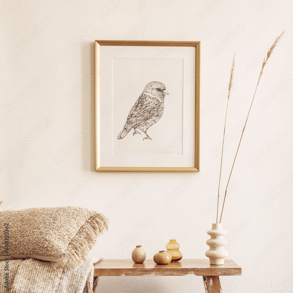 Fototapeta Stylish composition of living room interior with mock up frame, wooden bench, pillow, plaid, woman bag, dried flowers in vase, decortaion and elegant personal accessories in modern home decor.