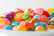 A Plate Of Colourful Jelly Beans On A White Background