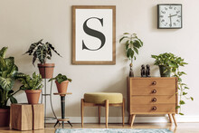 Vintage Interior Design Of Living Room With Stylish Retro Furnitures, A Lot Of Plants, Commode, Black Clock And Brown Poster Mock Up Frame On The Beige Wall. Stylish Home Decor. Template.