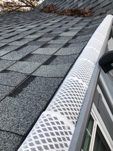 Cleaning Gutter In Autumn And Put Leave Filter To Protect Gutter From Leaves