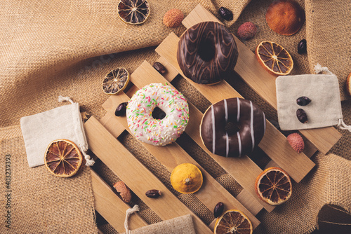 Fototapeta Donuts on wooden and linen background  obraz