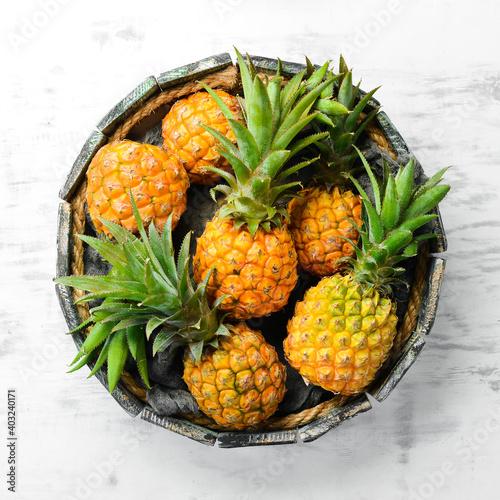 Fotografie, Obraz Pineapples in a wooden box