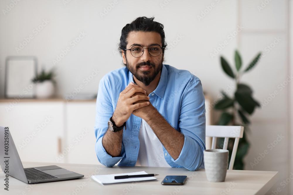 Fototapeta Millennial Freelancer. Portrait Of Young Arab Man At Desk In Home Office