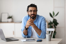 Millennial Freelancer. Portrait Of Young Arab Man At Desk In Home Office