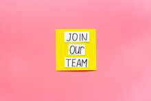 Join Our Team - Recruting Concept. Words Join Our Team On Paper Banner, Top View