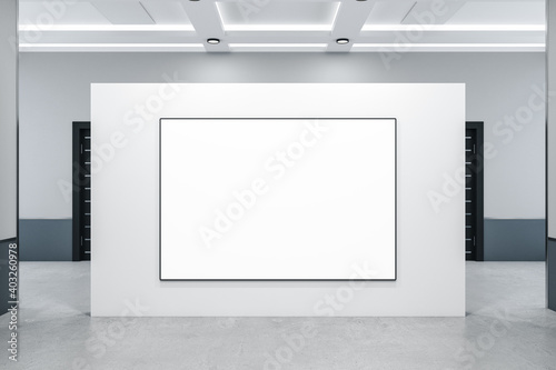 Modern concrete interior with blank banner on wall.