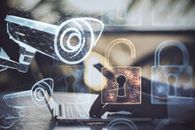 Hands Using Laptop With Polygonal Security Camera And Lock Icons