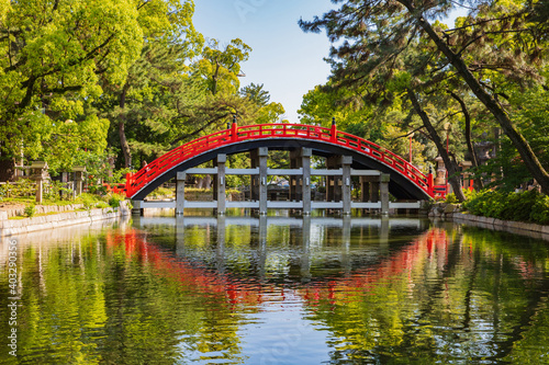 Fotografie, Obraz Osaka, Japan at the Red curve Bridge and reflection in the river at Sumiyoshi Taisha Shrine