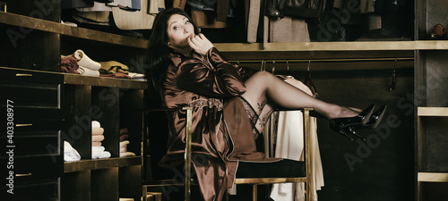 adult woman in peignoir and black stockings sits in a dressing room Fototapet