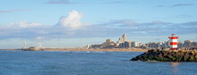 Panoramic View Over Scheveningen Pier, Beach, And Harbor Entrance With Lighthouse