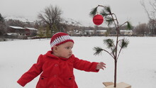 Baby With Charlie Brown Christmas Tree