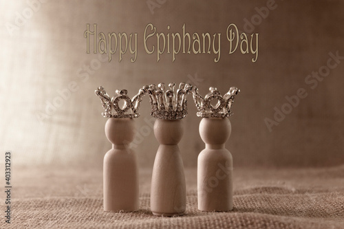 Three wise men figures with crowns on biege background and the text Happy Epiphany day Fototapete