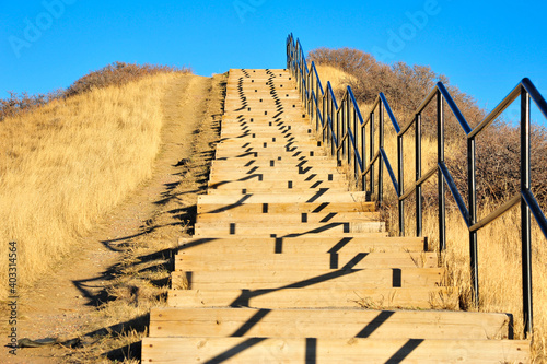 Papel de parede Steep stairs ascend to the city of Lethbridge, Alberta cast abstract shadows fro
