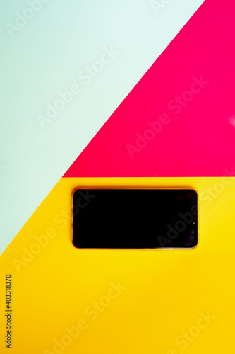 Fototapeta Empty phone isolated on pink yellow and blue background with copy space. obraz na płótnie