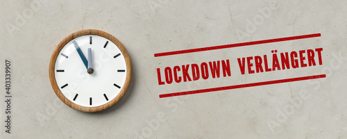 Obraz clock and  German message for LOCKDOWN EXTENDED on paper background - fototapety do salonu