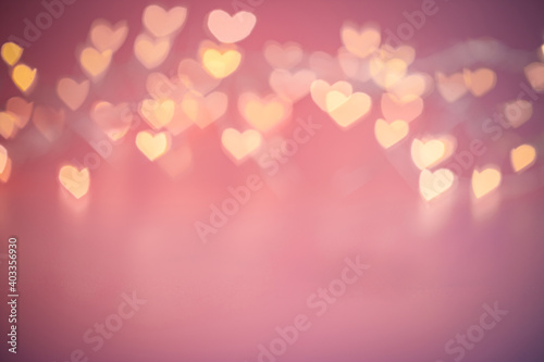Blurred hearts lights. Valentines day pink Bokeh background
