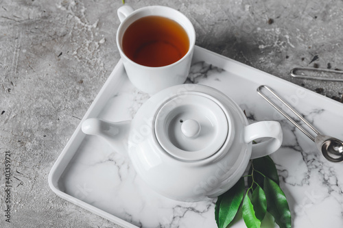 Obraz Beautiful teapot and cup of tea on table - fototapety do salonu