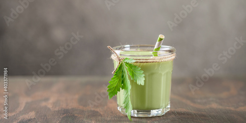 Obraz Cannabis herbal vegan gluten free lactose free milk and cannabis leaves. - fototapety do salonu