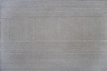 Thin Vertical And Horizontal Grooves On A Flat Ceramic Surface, Gray Background