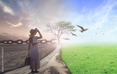 Obraz New normal concept: Woman standing between climate worsened with good atmosphere and birds - fototapety do salonu