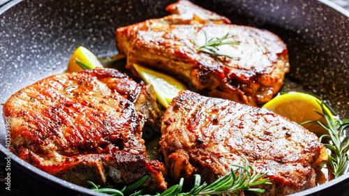 Fényképezés fried pork chops on a skillet, top view