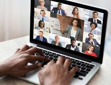Black Businessman Having Online Business Training Via Laptop In Office