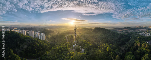 Panorama Aerial view of 5G Communication tower during beautiful sunrise with clo Fototapet