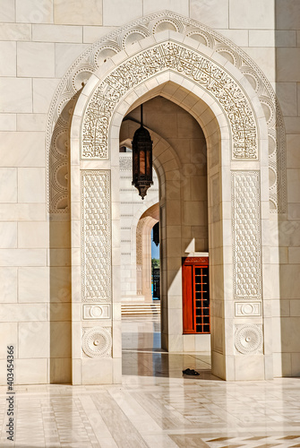 Fotografering Arches and walls inlaid between the courtyards of the Sultan Qaboos Grand Mosque